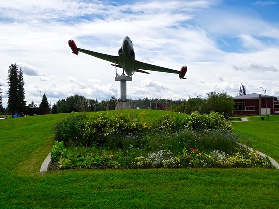 Edson, Canada: Garden and Plane in City Park Honoring Military Service, Near Hotel