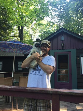 Babbling Brook Cottages: My husband and pup standing on the porch of cottage #4