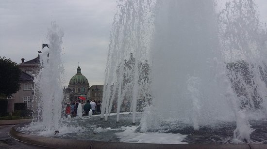 SANDEMANs NEW Copenhagen Tours: The fountain on the entrance of Royal palace