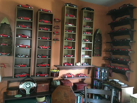Hyannis Port, MA: Inside his office. He collects model cars that he paints red!