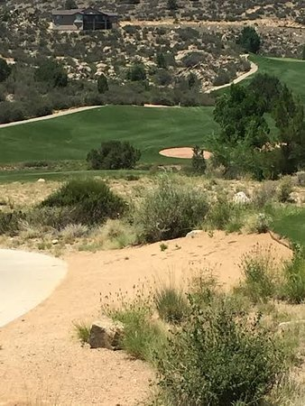 StoneRidge Golf Course: View from the front of an elevated red tee box.