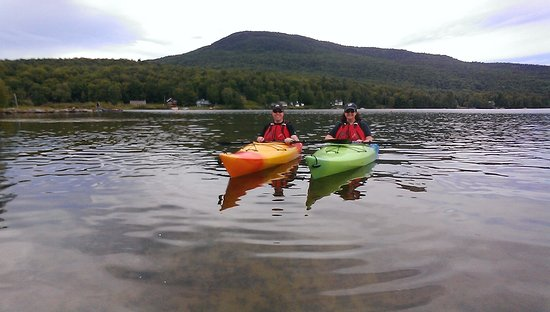 M & I kayaking in Lake Elmore, with Elmore Mountain in the background ..