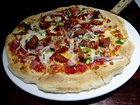 Timberwolf Pizza & Pasta Cafe: Close-up of Wood-Fired Rocky Mountain Pizza, Crisp and Tasty