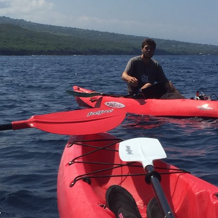 Ocean Safaris Kayak Adventures: One of our helpful guides and the view just before diving from the cliff.