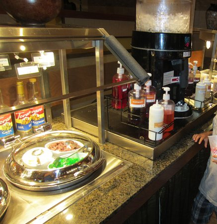 Genghis Khan Mongolian Grill: crushed ice machine and some of the toppings/syrups