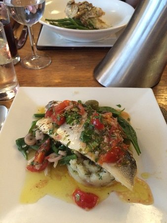 Hugo's: Baked fillet of sea bass, crushed new potatoes with with Niçoise salad and sauce vierge