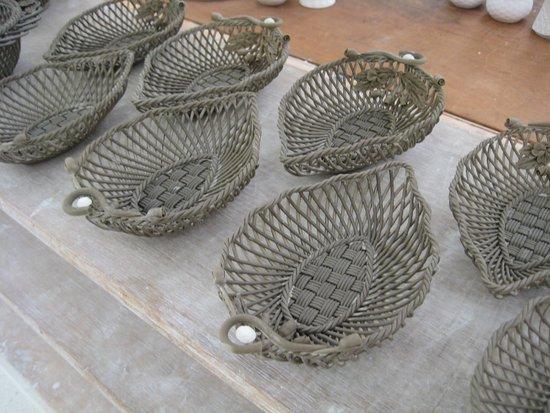 Belleek, UK: Handmade 'spagetti' ceramic baskets ready for baking.