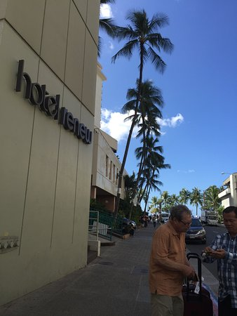Hotel Renew: paying the taxi driver; looking at the beach street beyond