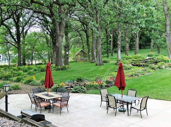 Spirit Lake, IA: The grounds feature massive bur oak trees shading the gardens and ponds.