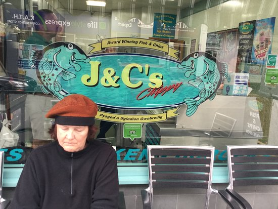 J & C's Chippy Restaurant: Writing in my journal at the outdoor seating at J&C's.