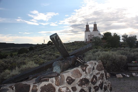 San Luis, CO: Stations of the Cross church in background
