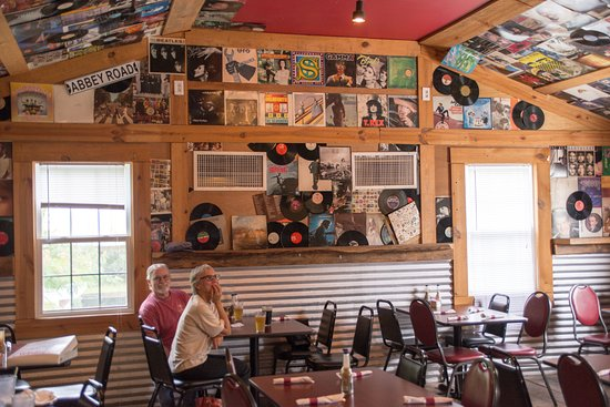 Oriental, NC: Walls and ceilings are plastered with LPs, 45s, and musical instruments.