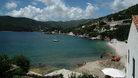 Villa Lanterna: View of Bay in Shtikovica. The man on the digger was cracking rocks for the beach.
