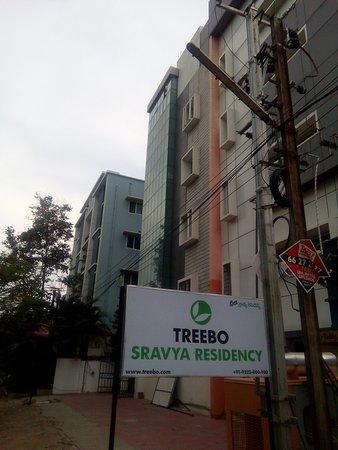 Treebo Sravya Residency: Facade Image with Treebo Logo