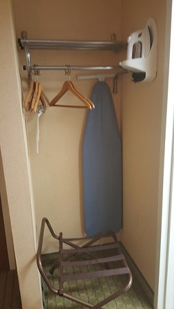 Super 8 Henrietta/Rochester Area: Iron & Ironing board in small closet space outside the bathroom