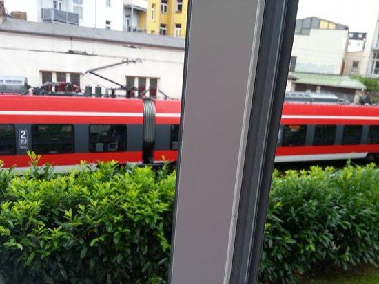 Hotel Amadeus: Passenger train seen through our bedroom window.
