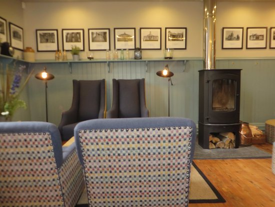 The Courthouse Cafe: Comfy sofa and log burner