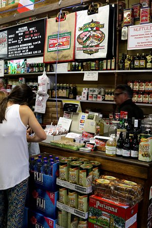 Central Grocery Company : galdly lined up at the counter to pay