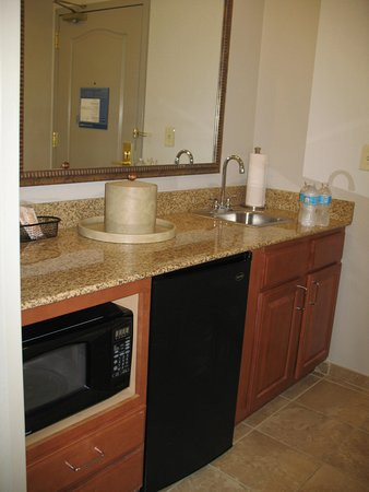 Hampton Inn & Suites Cedar Rapids - North: Microwave, refrigerator, sink, entrance to room unseen at right.