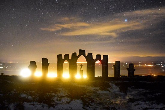 Fyrish Monument: A long exposure to capture the stars. The lights in the background at Alness and Evanton.