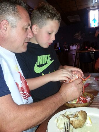 Myst Oceanside Restaurant & Lounge: son learning how to eat lobster.