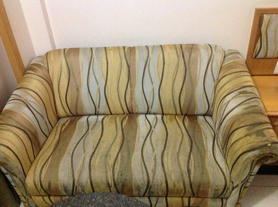 The worn out condition of the sofa. The sofa is torn. - Picture of ...