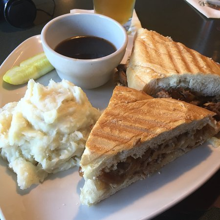Patrick's Pub & Eatery: French Dip Mashed potatoes and a pickle.
