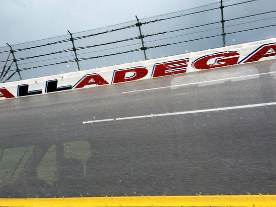 Talladega, AL: Turn 2, five stories high and sloped at 33 degrees! Notice the safety fence!