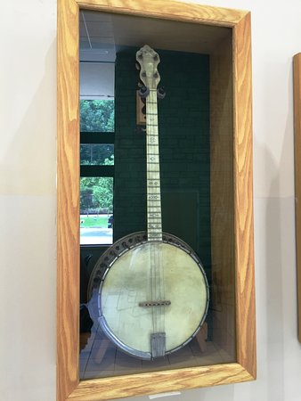 "Mountain Arts Center : Gibson ""Trap Door"" Tenor Banjo - part of the musical instruments exhibit"