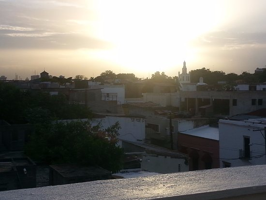 Hodelpa Caribe Colonial: Rooftop patio with a sunset view.