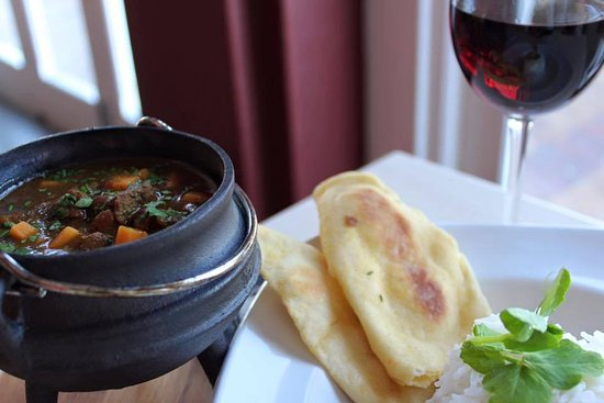 Fusion Restaurant : Cape Malay Lamb Curry Served With Naan Bread & Basmati Rice