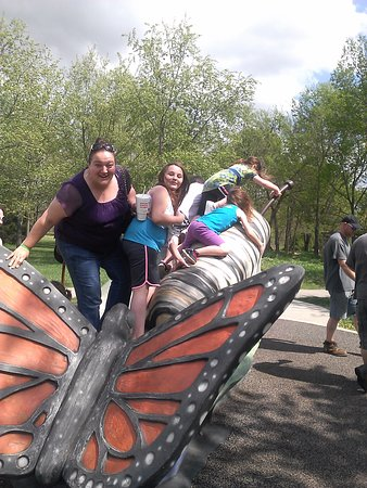 Nathanael Greene/Close Memorial Park: Climbing on the butterfly & caterpillar outside the butterfly house