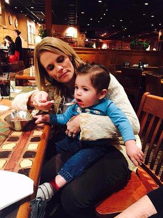Athens, Джорджия: My mom feeding my son some Tiramisu!