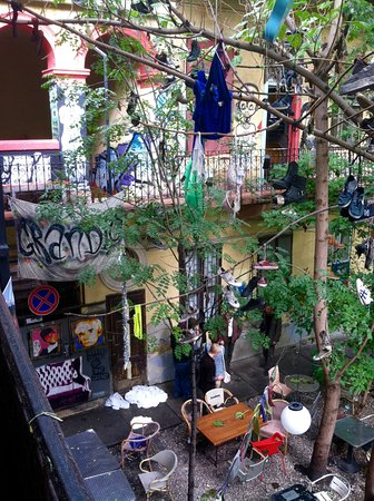 Grandio Party Hostel: view off the balcony in front of our room - courtyard very uniquely decorated to say the least!