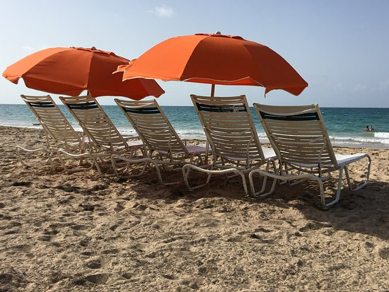 Doubletree By Hilton San Juan Ocean Park Beach Lounge Chairs And Umbrellas Are Included