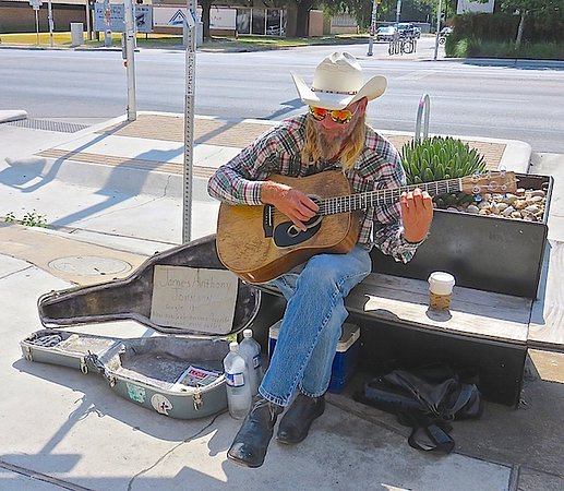SoCo District : James Anthony Johnson plays and sings daily in front of the SoCo Cafe.