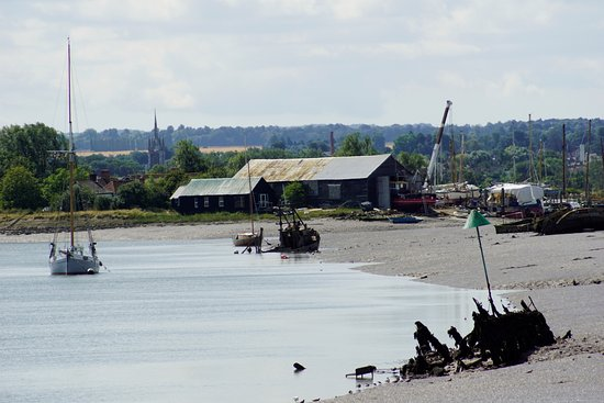 Oare, UK: shipwreck and boat in the water