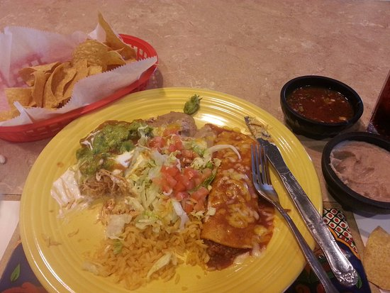 Windsor, CO: Chicken Chimiganga, Beef Enchilada served with guacamole, sour cream, refried beans, spanish ric
