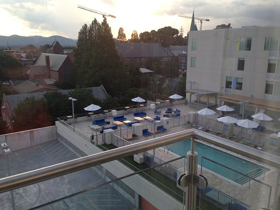 Aloft Asheville Downtown: view from Room 634 balcony - pool and parking garage with distant mountains