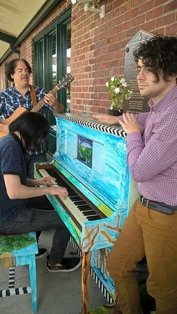 The Posies at the Capitol Markets Art Piano which was painted by the Charleston Art Group