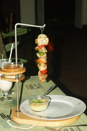 Crochu, Grenada: Flaming fish kabobs and potato souffle.