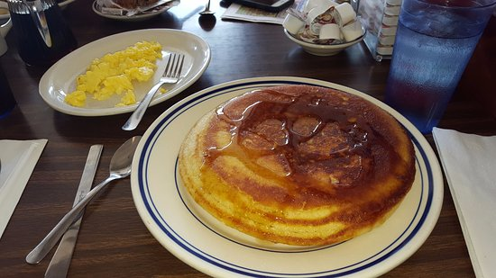 Vermilion, OH: My colossal pancake with two eggs scrambled.