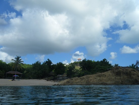 Galley Bay Cottages: View from the beach. Sea Breeze and the Main Villa