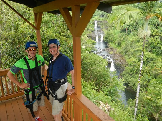 Hakalau, HI: My 60+ year old dad and I. He was zipping upside down by the end!