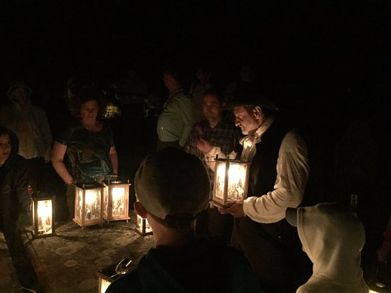 Annapolis Royal Candlelight Graveyard Tour: Gathered around a grave listening to a story.