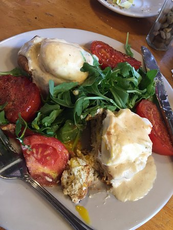 Bristol, RI: Rosemary biscuit, poached egg, four cheese sauce, arugula and grilled tomatoes