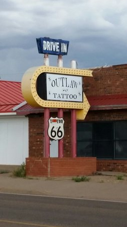 Motel Safari: Across the street from the Drine-In Tattoo Shop.