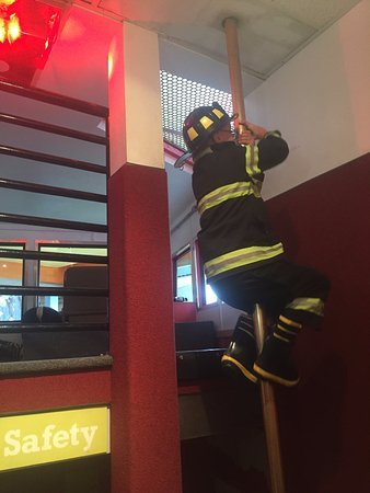 Children's Museum and Theatre of Maine : Fire truck has a fire pole & dress up clothes