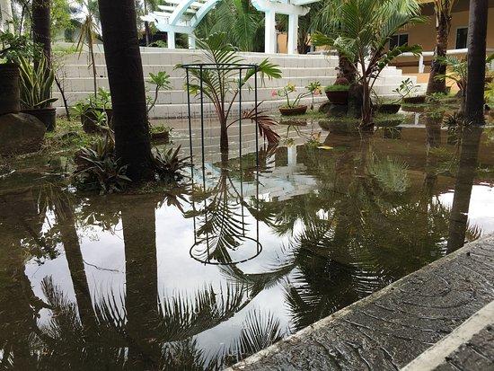Phi Phi Hotel and Beach Resort: Flooded outside the villa - it's no longer raining!