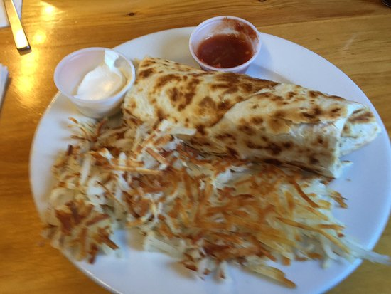 Carolyn's Cafe: Sausage burrito with hash browns, sour cream, and salsa